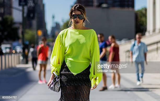 Thassia Naves wearing a neon top outside Vera Wang on September 13 2016 in New York City