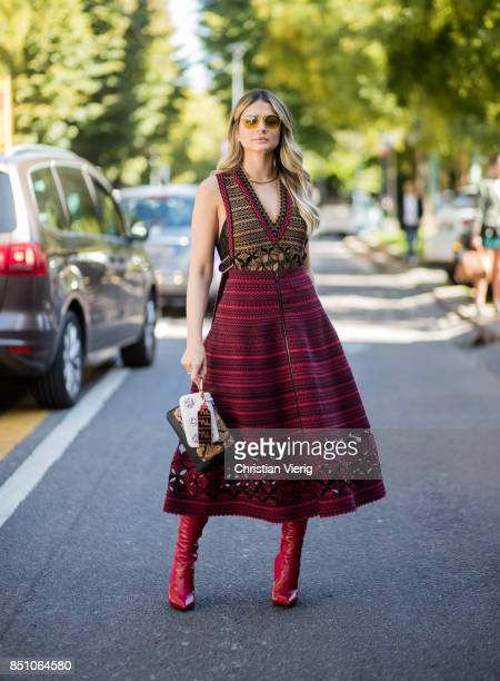 Thassia Naves wearing a red dress is seen outside Fendi during Milan Fashion Week Spring/Summer 2018 on September 21 2017 in Milan Italy