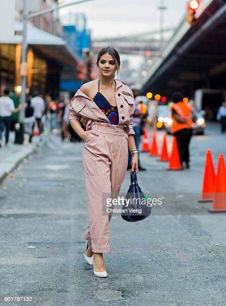 Thassia Naves wearing an overall outside Tommy Hilfiger on September 9 2016 in New York City