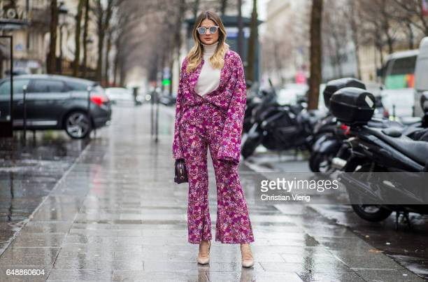 Thassia Naves wearing an overall with floral print outside Giambattista Valli on March 6 2017 in Paris France