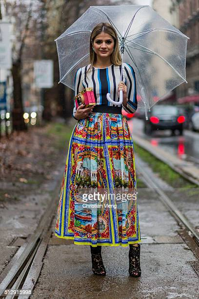 Thassia Naves wearing Dolce Gabbana skirt shoes top and bag seen outside Dolce Gabbana during Milan Fashion Week Fall/Winter 2016/17 on February 28...