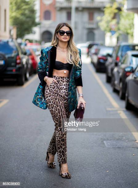 Thassia Naves wearing pants with leo print cropped top is seen outside Dolce Gabbana during Milan Fashion Week Spring/Summer 2018 on September 24...
