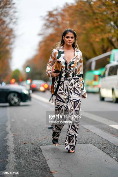 Thassia Naves wears a colored print blazer jacket and suit pants outside John Galliano during Paris Fashion Week Womenswear Spring/Summer 2018 on...
