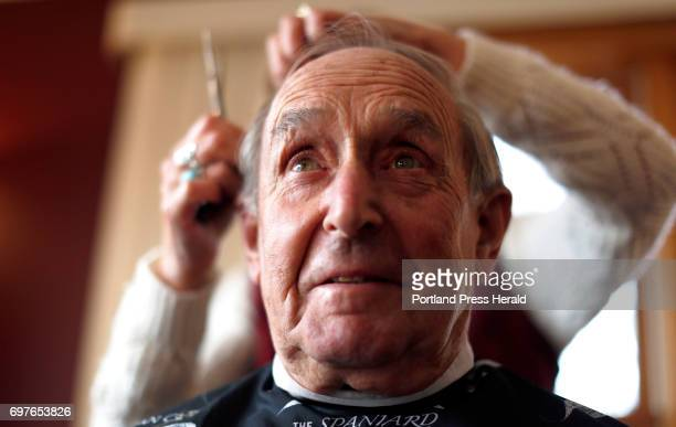 That Moment Allan Dolloff sits in a barber chair while cosmetologist Donna Kenison applies the scissors to his hair