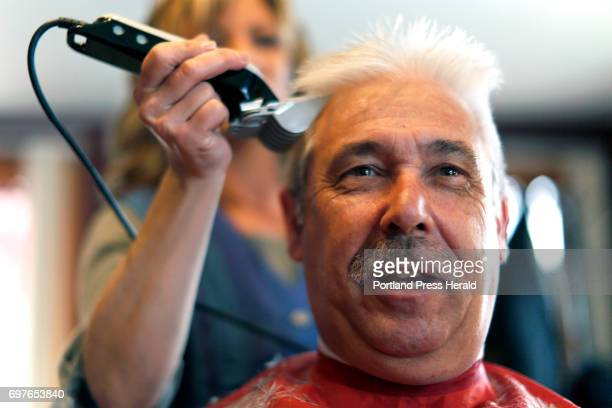 That Moment Jim Dolloff sits in a barber chair while cosmetologist Leanne Jackson wields the clippers at Cuttin' It Close barbershop