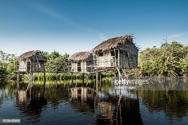 Thatch houses built over rural lake