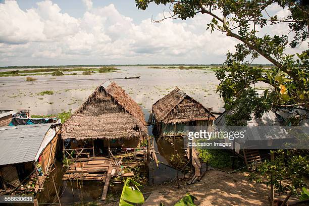 Thatched huts on Amazon River Iquitos Peru
