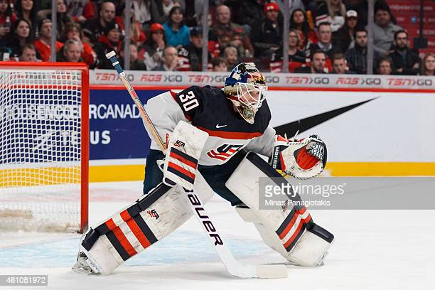 Thatcher Demko of Team United States looks towards the play in a preliminary round game during the 2015 IIHF World Junior Hockey Championships...