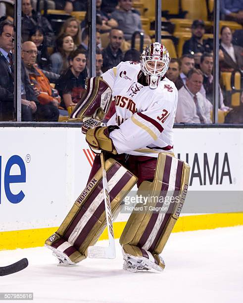 Thatcher Demko of the Boston College Eagles passes the puck against the Harvard Crimson during NCAA hockey in the semifinals of the annual Beanpot...