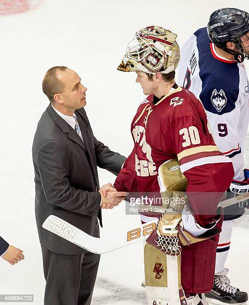 Thatcher Demko of the Boston College Eagles shakes hands with Mike Cavanaugh of the Connecticut Huskies after NCAA hockey at the XL Center on...