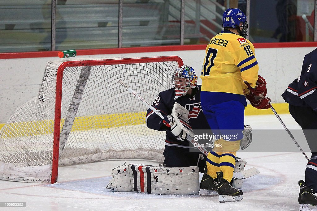 Thatcher Demko #29 of the USA is scored on by Robert Hagg #4 (not pictured) of Sweden as teammate Rasmus Fyrpihl #10 sets up in front during the U-18 Four Nations Cup on November 9, 2012 at the Ann Arbor Ice Cube in Ann Arbor, Michigan. USA won 5-3.
