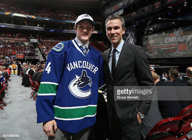 Thatcher Demko of the Vancouver Canucks meets with team President Trevor Linden after being drafted on Day Two of the 2014 NHL Draft at the Wells...