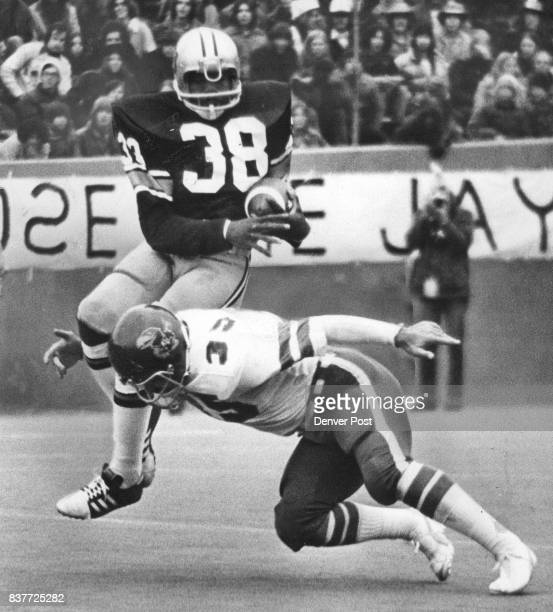 That's all the farther you're going to get on this play Linebacker Odell Weidner of Kansas puts skids to Colorado tailback Billy Waddy late in first...