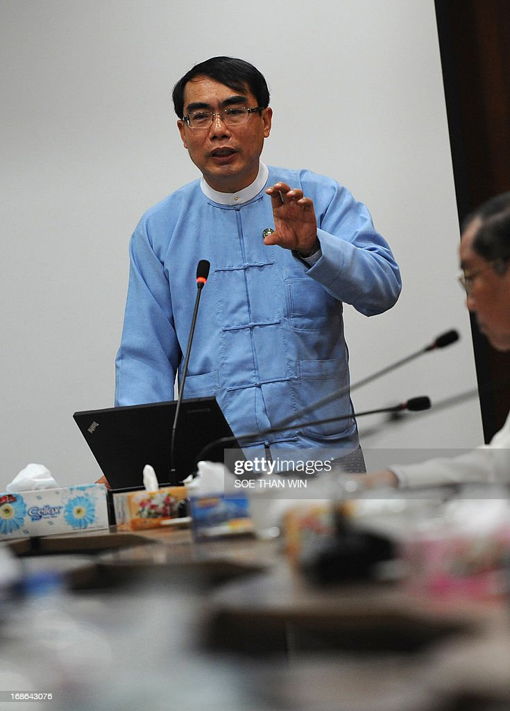 Thaung Tin Deputy Minister Ministry of Communications and Information Technology member of Telecommunications Tender Selection committee talks to the...