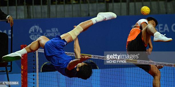 Thawisak Thongsai of Thailand kicks the ball against Malaysia during the men's team sepaktakraw preliminary round match at the 28th Southeast Asian...
