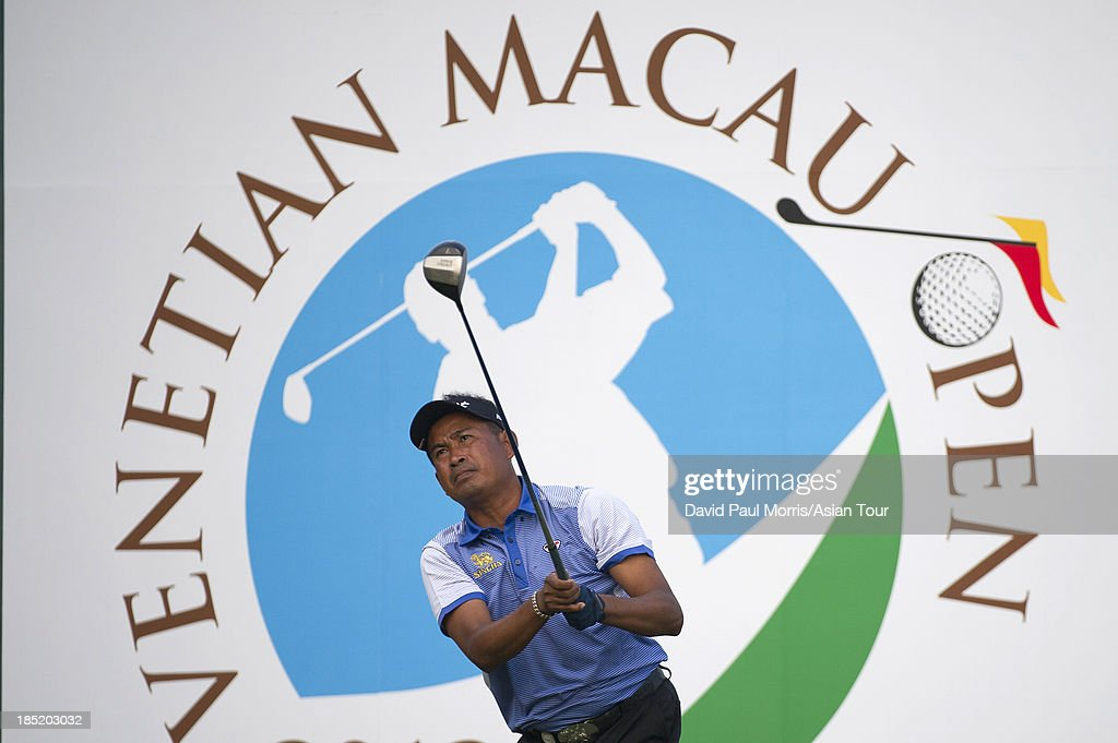 <a gi-track='captionPersonalityLinkClicked' href=/galleries/search?phrase=Thaworn+Wiratchant&family=editorial&specificpeople=221640 ng-click='$event.stopPropagation()'>Thaworn Wiratchant</a> of Thailand hits his tee shot on the 18th hole during round two of the Venetian Macau Open on October 18, 2013 at the Macau Golf & Country Club in Macau. The Asian Tour tournament offers a record US$ 800,000 prize money which goes through October 20.