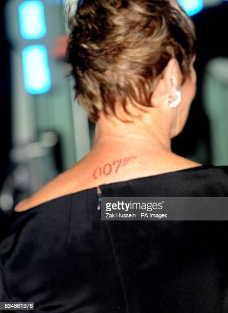 The 007 James Bond logo on the back of Dame Judi Dench's neck as she arrives for the World premiere of 'Quantum Of Solace' at the Odeon Leicester...