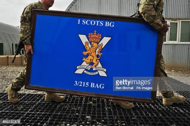 The 1 Scots insignia is carried to the Quarter Master Stores for storage after a flag handover ceremony at camp Toombstone Afghanistan as 1 Scots...