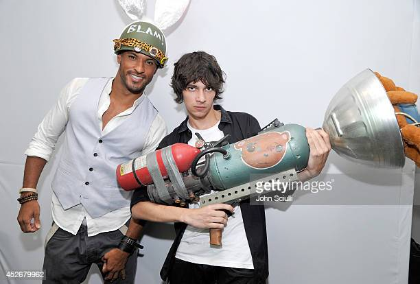 'The 100' actors Ricky Whittle and Devon Bostick snap a photo with Sunset Overdrive's TNT Teddy in the Microsoft VIP Lounge during ComicCon on July...