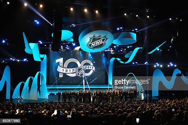 The '100 Greatest NHL Players of All Time' stand on the stage during the NHL 100 presented by GEICO Show as part of the 2017 NHL AllStar Weekend at...