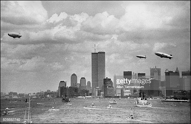 The 100th Anniversary of the Statue of Liberty is celebrated in New York harbor New York New York July 3 1986 Three blimps the World Trade Center and...
