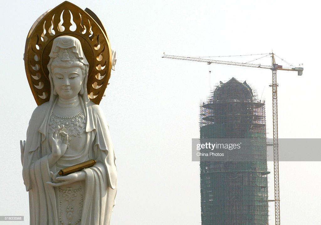 The 108metrehigh statue of the South Sea Avalokitesvara also known as the Goddess of Mercy or Guanyin stands under construction on December 6 2004 in...