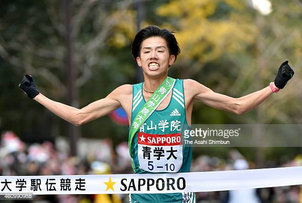 The 10th and final runner of Aoyama Gakuin University Yuya Ando crosses the finishing line to win in the 91st Hakone Ekiden on January 3 2015 in...