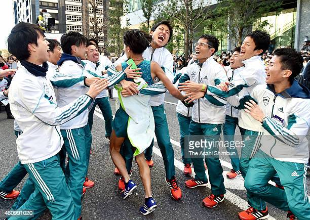 The 10th and final runner of the Aoyama Gakuin University Yuya Ando is welcomed by his teammates to celebrate winning in the 91st Hakone Ekiden on...