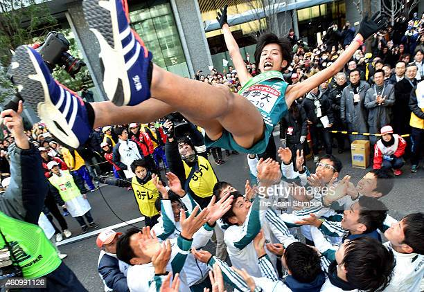 The 10th and final runner of the Aoyama Gakuin University Yuya Ando is thrown into the air by his teammates to celebrate winning in the 91st Hakone...