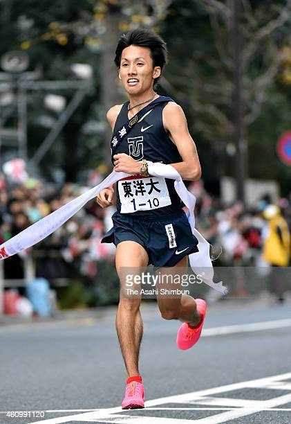 The 10th and final runner of the Toyo University Genta Yodokawa crosses the finishing tape as third during day two of the 91st Hakone Ekiden on...