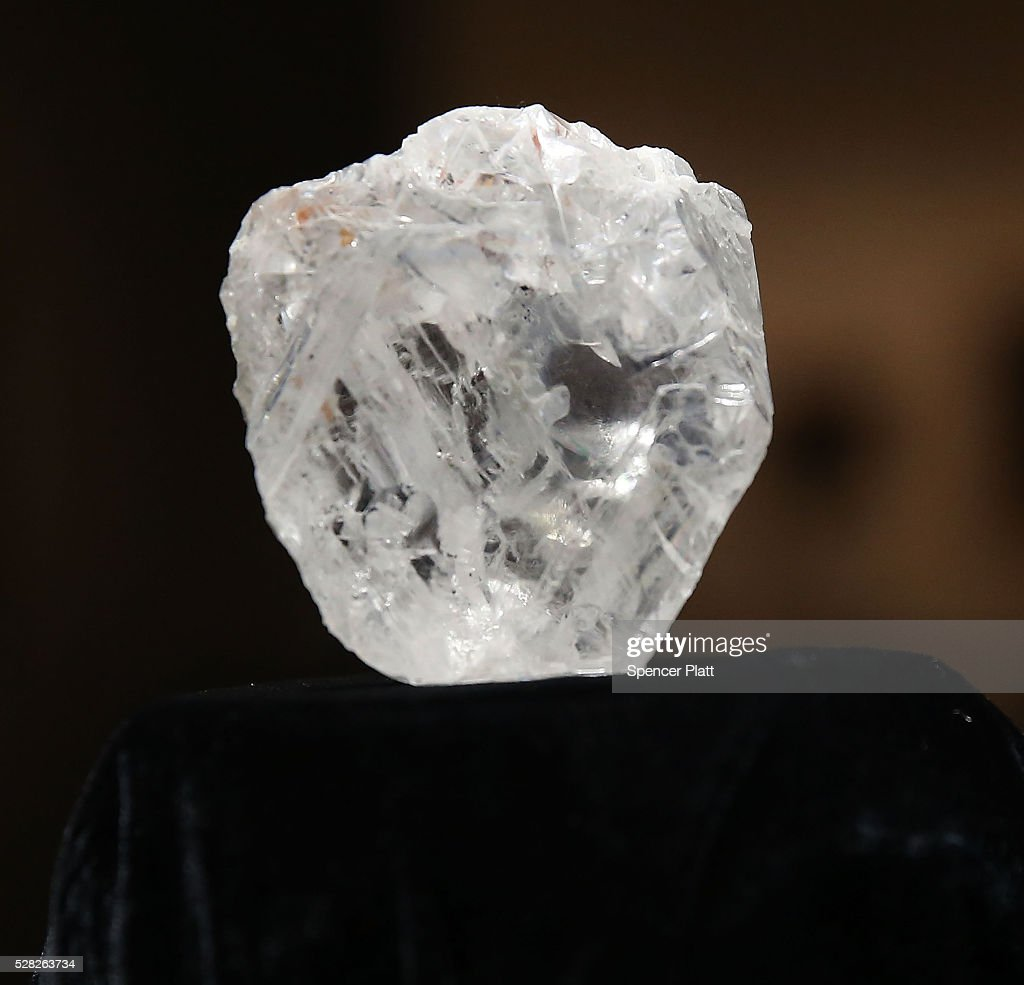 The 1109-carat rough Lesedi La Rona diamond, the biggest rough diamond discovered in more than a century, sits in a display case at Sotheby's on May 4, 2016 in New York City. The stone was found by Lucara Diamond Corp. last year at its Karowe mine in Botswana. The diamond, which is nearly the size of a tennis ball at 66.4 x 55 x 42mm and is believed to be about 2.5 billion to 3 billion years old, was named 'Our Light' in the local Tswana language. Lesedi La Rona will be offered at auction in London on June 29 and be on display at Sotheby's New York. The diamond could sell for $70 million or more.