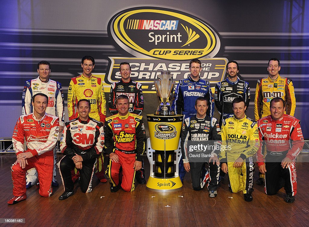 The 12 drivers competing for the NASACAR Chase Championship pose for a group photo (L-R) standing, <a gi-track='captionPersonalityLinkClicked' href=/galleries/search?phrase=Dale+Earnhardt+Jr.&family=editorial&specificpeople=171293 ng-click='$event.stopPropagation()'>Dale Earnhardt Jr.</a> <a gi-track='captionPersonalityLinkClicked' href=/galleries/search?phrase=Joey+Logano&family=editorial&specificpeople=4510426 ng-click='$event.stopPropagation()'>Joey Logano</a>, <a gi-track='captionPersonalityLinkClicked' href=/galleries/search?phrase=Kurt+Busch&family=editorial&specificpeople=201728 ng-click='$event.stopPropagation()'>Kurt Busch</a>, <a gi-track='captionPersonalityLinkClicked' href=/galleries/search?phrase=Carl+Edwards&family=editorial&specificpeople=193803 ng-click='$event.stopPropagation()'>Carl Edwards</a>,Jimmy Johnson and <a gi-track='captionPersonalityLinkClicked' href=/galleries/search?phrase=Kyle+Busch&family=editorial&specificpeople=211123 ng-click='$event.stopPropagation()'>Kyle Busch</a>, (L-R) kneeling, <a gi-track='captionPersonalityLinkClicked' href=/galleries/search?phrase=Kevin+Harvick&family=editorial&specificpeople=209186 ng-click='$event.stopPropagation()'>Kevin Harvick</a>, <a gi-track='captionPersonalityLinkClicked' href=/galleries/search?phrase=Greg+Biffle&family=editorial&specificpeople=209093 ng-click='$event.stopPropagation()'>Greg Biffle</a>, <a gi-track='captionPersonalityLinkClicked' href=/galleries/search?phrase=Clint+Bowyer&family=editorial&specificpeople=537951 ng-click='$event.stopPropagation()'>Clint Bowyer</a>, <a gi-track='captionPersonalityLinkClicked' href=/galleries/search?phrase=Kasey+Kahne&family=editorial&specificpeople=183374 ng-click='$event.stopPropagation()'>Kasey Kahne</a>, <a gi-track='captionPersonalityLinkClicked' href=/galleries/search?phrase=Matt+Kenseth&family=editorial&specificpeople=204192 ng-click='$event.stopPropagation()'>Matt Kenseth</a> and Ryan Newman on September 12, 2013 in Chicago, Illinois. The 12 drivers competing for the NASACAR Chase Championship