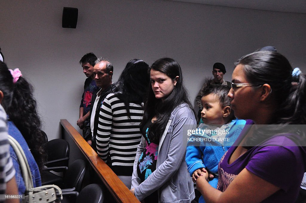 The 14 farmers tried for the June 15, 2012 slaughter of Curuguaty, where 11 farmers and 6 policemen were killed, appear in court in Coronel Oviedo, Paraguay, on February 14, 2013. The hearing was postponed after the defence of the accused challenged judge Jose Benitez.
