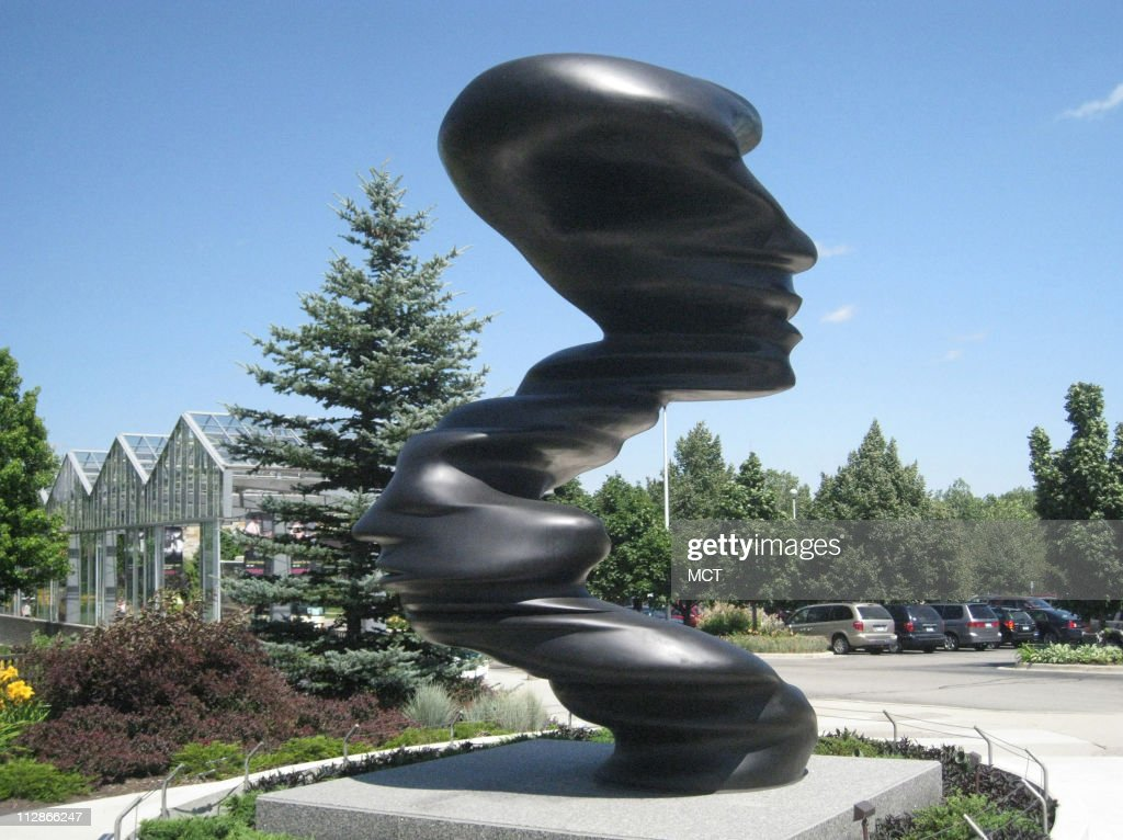 The 15foot bronze sculpture 'Bent of Mind' by Tony Cragg graces the entrance to Frederik Meijer Gardens and Sculpture Park in Grand Rapids Michigan