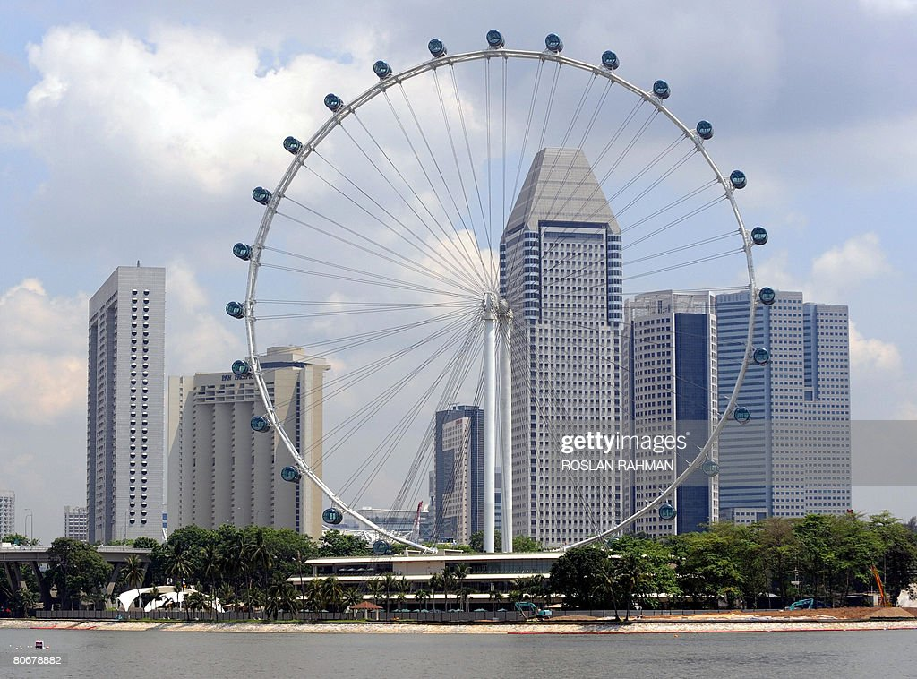 The 165 meter high Singapore flyer stands against the highrise buildings in Singapore on April 15, 2008. Singapore flyer, the world's largest observation wheel which offers breathtaking, panoramic view of the city state and neighbouring countries is officially open to public on April 15.