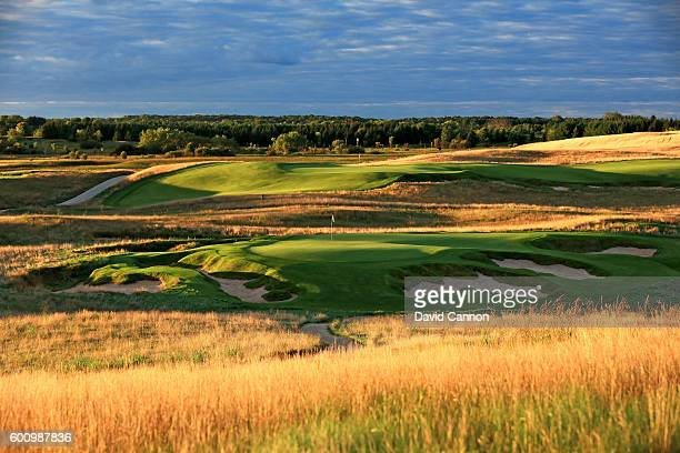 The 165 yards par 3 ninth hole with the green on the par 5 18th hole behind at Erin Hills Golf Course the venue for the 2017 US Open Championship on...