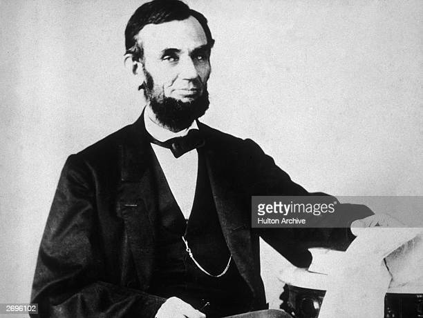 The 16th American president Abraham Lincoln sitting and leafing through documents Washington DC