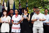 The 18 new Australian Citizens onstage during the ceremony in Hyde Park as part of Sydney's Australia day celebrations on January 26 2009 in Sydney...