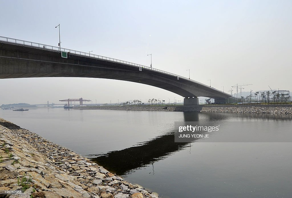 The 18-kilometre-long channel, 80 meters wide and 6.3 meters deep, called 'Gyeongin Ara Waterway' is seen under a bridge in Gimpo near Seoul on May 25, 2012. The 1.9 billion USD canal linking Seoul to the Yellow Sea opened after two decades of controversy which halted or delayed construction.