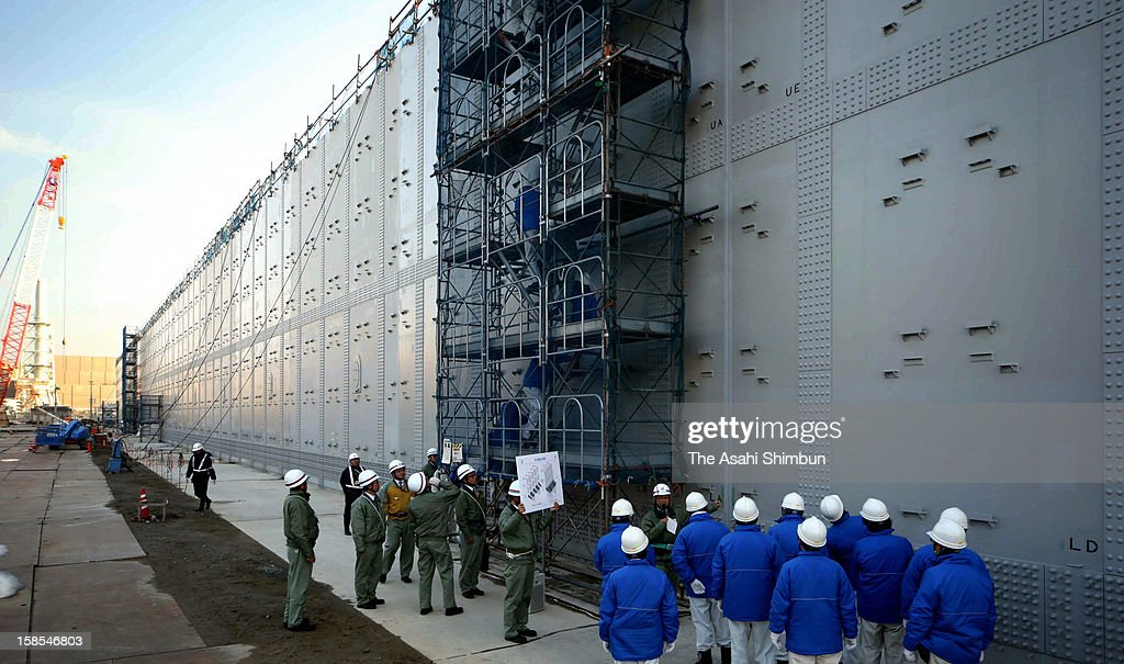 The 18-meter-high breakwater is under construction in preparation for possible huge earthquake and tsunami, at Chubu Electric Power Co Hamaoka Nuclear Power Plant on December 18, 2012 in Omaezaki, Shizuoka, Japan. The wall is under construction across the 1.6 kilometers coast line of the premise, will be completed in March 2013.