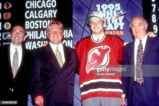 The 18th pick of the 1995 NHL Draft Petr Sykora stands with NHL commissioner Gary Bettman Director of Scouting for the New Jersey Devils David Conte...