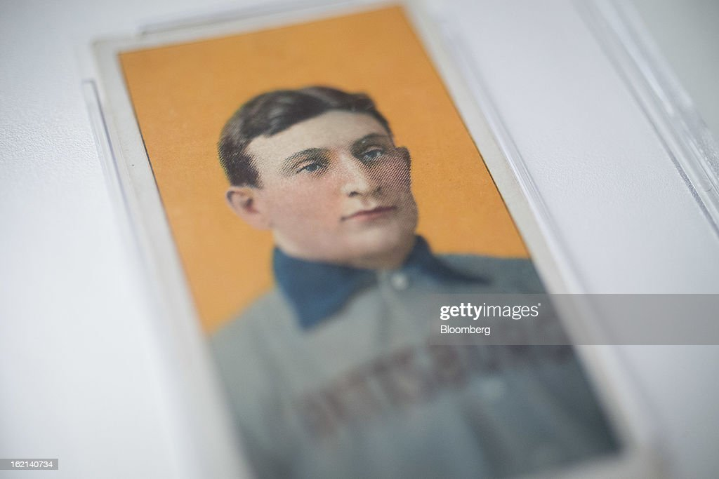 The 1909 baseball card of Pittsburgh Pirates shortstop Honus Wagner is displayed for a photograph in New York, U.S., on Tuesday, Feb. 19, 2013. The trading card that the National Baseball Hall of Fame calls the sport's 'most famous collectible' will be up for sale starting Feb. 25, and might fetch more than $2.8 million, according to the auction house. Photographer: Scott Eells/Bloomberg via Getty Images