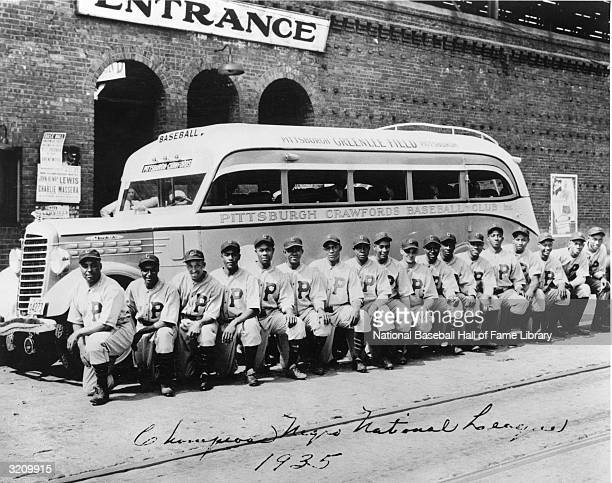 The 1935 Pittsburgh Crawfords of the Negro Leagues pose for a team photo in front of their team bus The Crawfords are considered the greatest black...