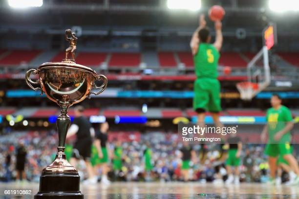 The 1939 NCAA Tournament Championship trophy is seen on the court as the Oregon Ducks practice ahead of the 2017 NCAA Men's Basketball Final Four at...