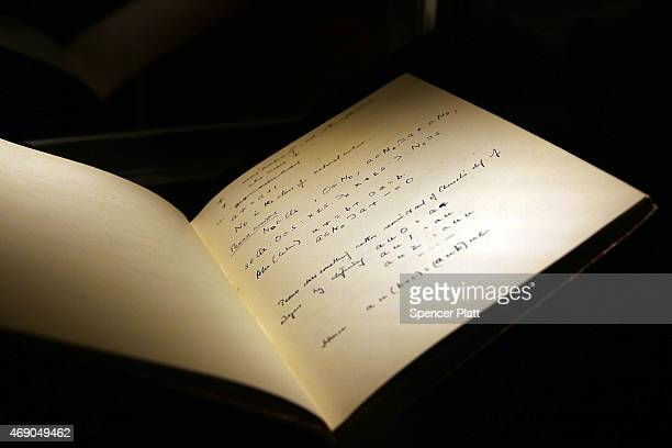The 1942 56page notebook belonging to codebreaker Alan Turing is displayed at Bonham's auction house on April 9 2015 in New York City The notebook...