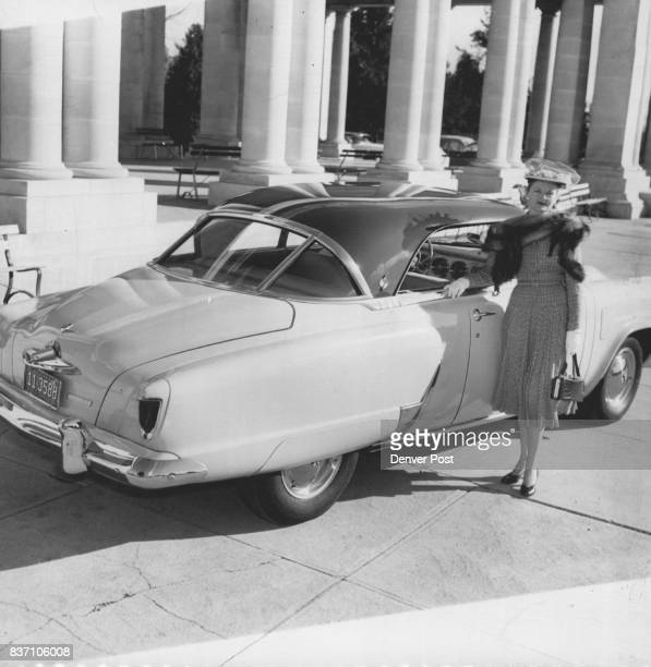 The 1952 model car and pavilion at Chessman park make an attractive backdrop for Mrs Alfred Hicks II who is attired in a classic suit of imported...