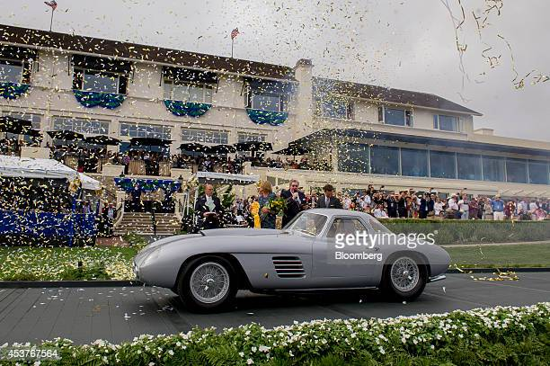 The 1954 Ferrari 375 MM Scaglietti Coupe owned by Jon Shirley is driven onto the winners ramp after being named Best of Show during the 2014 Pebble...