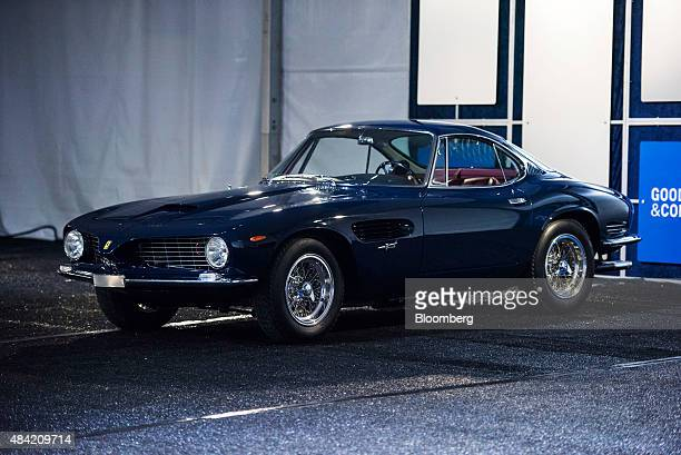 The 1962 Ferrari SpA 250 GT SWB Berlinetta Speciale stands after being sold for US$15000 during the Gooding and Company auction at the 2015 Pebble...