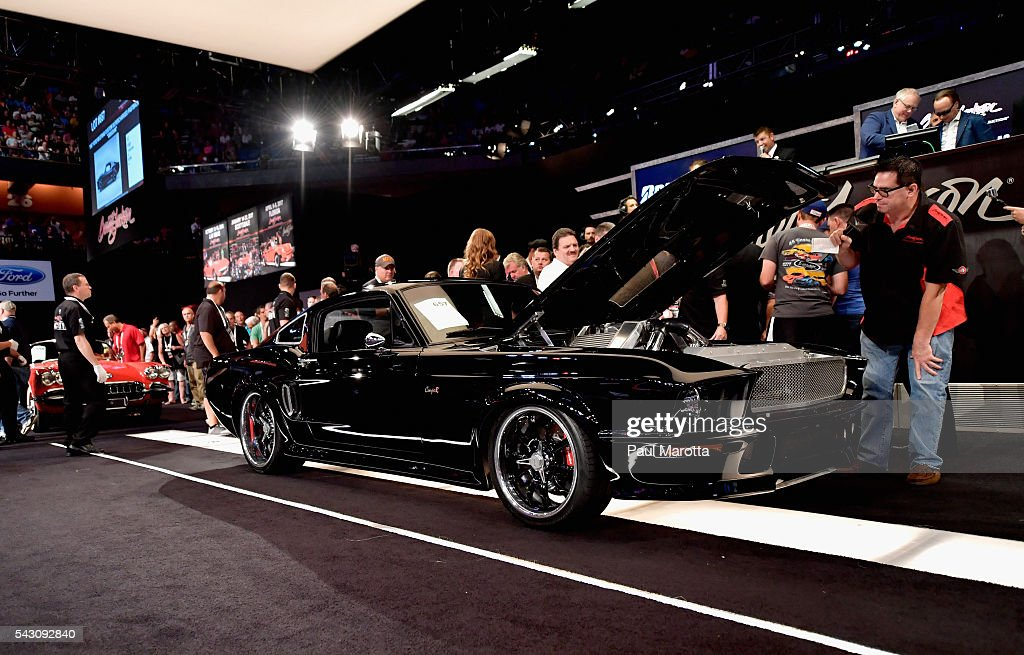 The 1967 Ford Mustang Custom Supercharged Fastback 'Obsidian' is auctioned at the Barrett-Jackson Inaugural Northeast Auction at Mohegan Sun Arena on June 25, 2016 in Uncasville, Connecticut. Organizers estimated app. 70,000 vistors attended the three day auction June 23-25 during which hundreds of collectors were sold at auction.