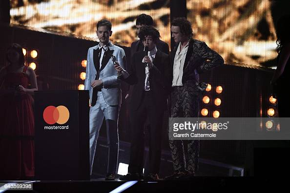 The 1975's Matthew Healy Adam Hann George Daniel and Ross MacDonald receive the award for Best British Group on stage at The BRIT Awards 2017 at The...